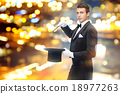 magician in top hat with magic wand showing trick 18977263