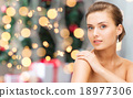 beautiful woman with diamond earrings and bracelet 18977306