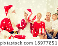 smiling family with santa claus and gifts at home 18977851