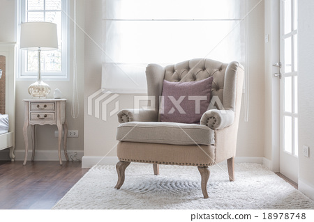 Stock Photo: classic chair on carpet with pillow