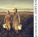 Mongolian Couple Farmers Holding Basin Posing Field Concept 18985428