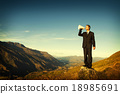 Businessman Shouting on the Top of the Mountain Concept 18985691