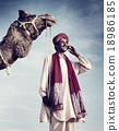 Indian Man Phone Camel Communication Technology Concept 18986185