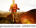 Extreme Hiking Across Rugged Mountains Concept 18989589