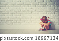 little child girl crying and sad about brick wall 18997134