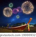 Fireworks above tropical landscape, Thailand 19000932