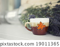 Christmas cup on wooden table with copy space. 19011365
