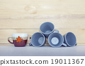 Christmas cup on wooden table with copy space. 19011367