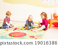Three kids playing with toys 19016386
