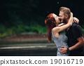 beautiful couple hugging in the rain 19016719