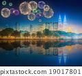 Fireworks above cityscape of Kuala Lumpur  19017801