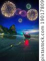 Fireworks above tropical landscape, Thailand 19017809