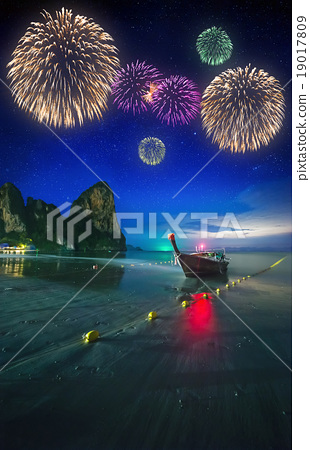 Fireworks above tropical landscape, Thailand 19017809