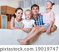 Relaxed family in domestic interior 19019747