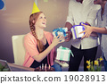 Happy businesswoman receiving birthday gifts 19028913