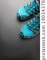 Blue running shoes on grey 19034376