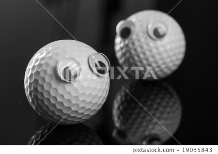 Two golf balls with plastic eyes 19035843