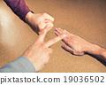 Hands playing paper rock scissors 19036502