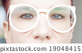 closeup of woman with eyeglasses 19048415