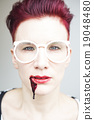 portrait of woman with bloody mouth 19048480