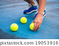 Athletes keep the tennis ball on a tennis court 19053916