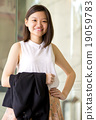 Young female Asian executive smiling portrait 19059783