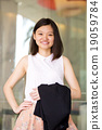 Young female Asian executive smiling portrait 19059784