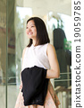 Young female Asian executive smiling portrait 19059785