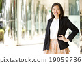 Young female Asian executive smiling portrait 19059786