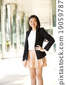 Young female Asian executive smiling portrait 19059787