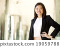 Young female Asian executive smiling portrait 19059788
