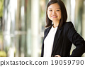 Young female Asian executive smiling portrait 19059790