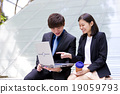 Young Asian business executives in discussion 19059793