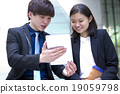 Young Asian business executives in discussion 19059798