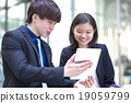 Young Asian business executives in discussion 19059799