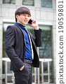 Young Asian male business executive use phone 19059801