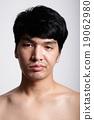 Headshot of Asian man face with no makeup 19062980