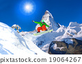 Snowboarder jumping against Matterhorn peak  19064267