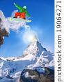 Snowboarder jumping against Matterhorn peak  19064271