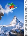 Snowboarder jumping against Matterhorn peak  19064275