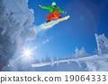 Snowboarder jumping against blue sky 19064333