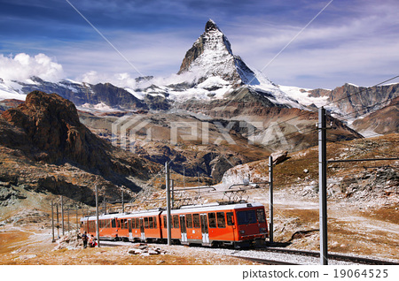 Matterhorn peak with a train in Swiss Alps 19064525