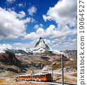 Matterhorn peak with a train in Swiss Alps 19064527