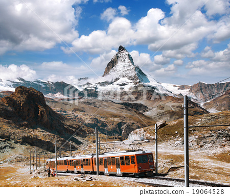 Matterhorn peak with a train in Swiss Alps 19064528