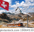 Matterhorn peak with a train in Swiss Alps 19064530