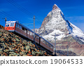 Matterhorn peak with a train in Swiss Alps 19064533
