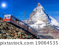 Matterhorn peak with a train in Swiss Alps 19064535