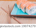 California maki sushi with fish and chopsticks 19074270