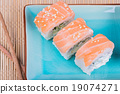 Top view to california maki sushi with salmon 19074271