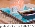 California maki sushi with fish and soy sauce 19074272